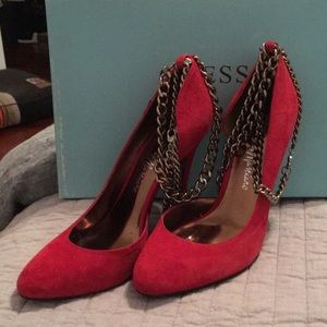 Red suede pumps with removable chains
